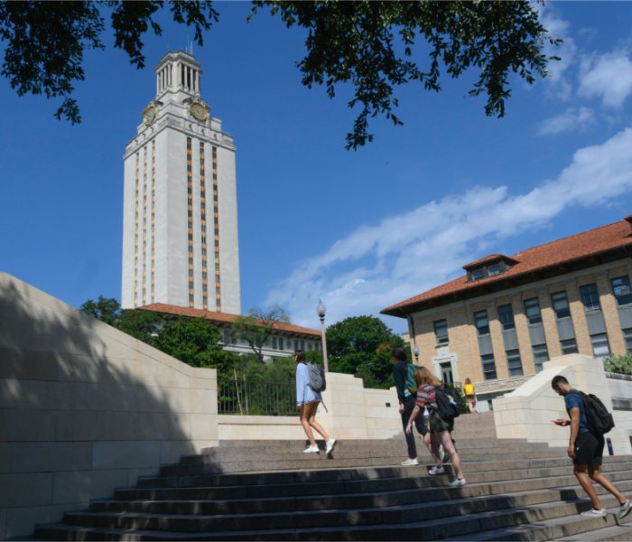 UT Tower with students climbing stairs
