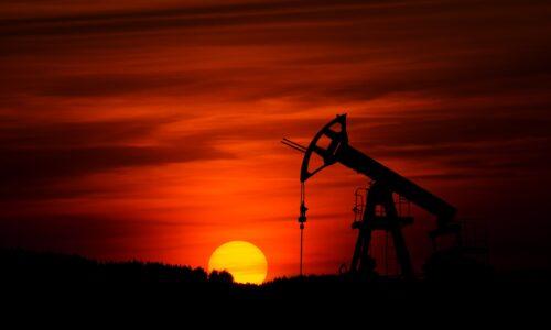 sunrise in an oil field